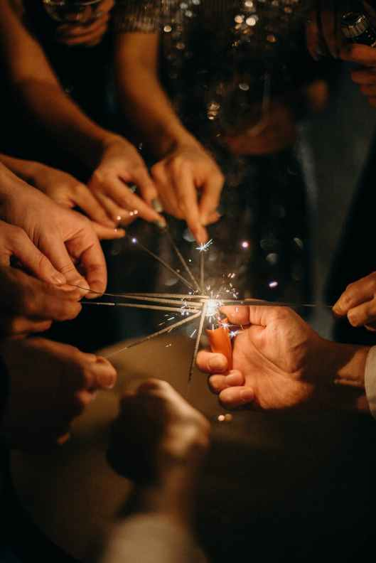 people lighting sparklers